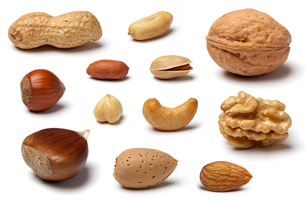 variety of nuts on white - cashew stock photos and pictures