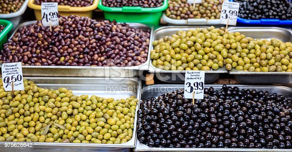 istock Variety of olives for sale at an open-air market 975628642