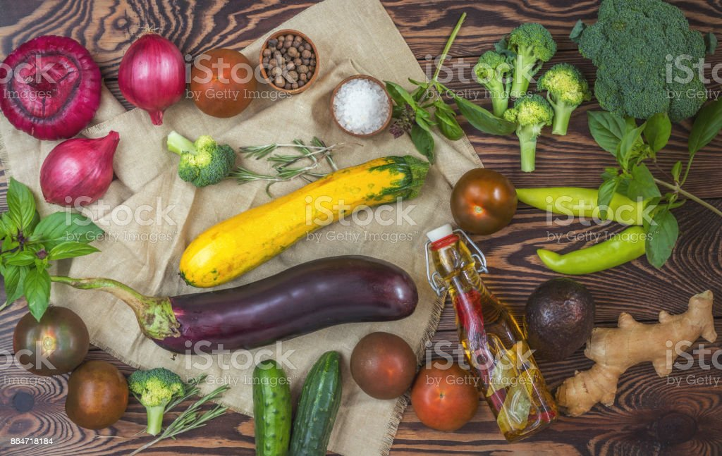 Variety of organic fresh vegetables on wooden background stock photo