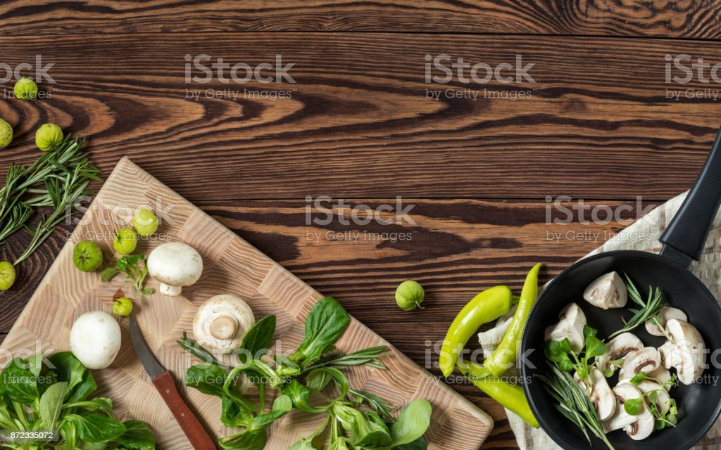 Variety of organic fresh vegetables on wooden background royalty-free stock photo