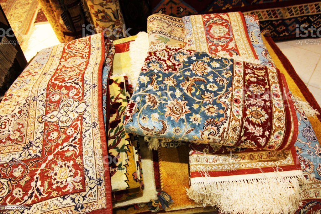 Variety of Persian carpets at grand bazaar in Isfahan,Iran stock photo