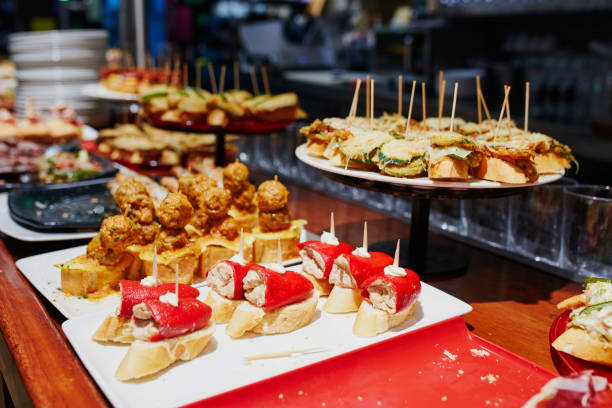 Variety of pinchos (pintxos) in bar of San Sebastian (Donostia), Spain stock photo