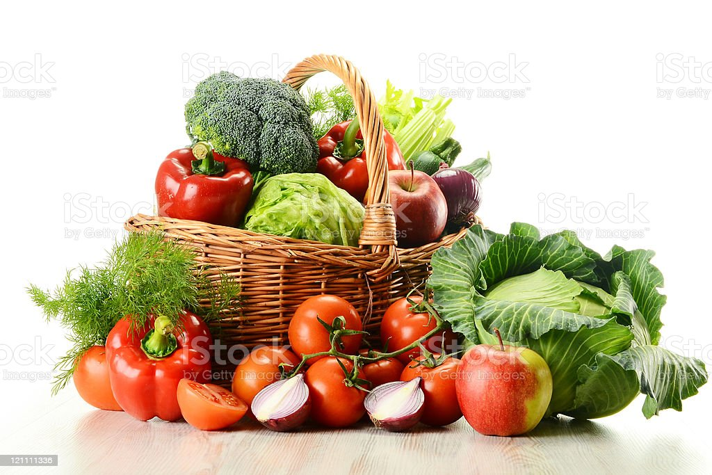Variety of raw vegetables in wicker basket isolated on white stock photo