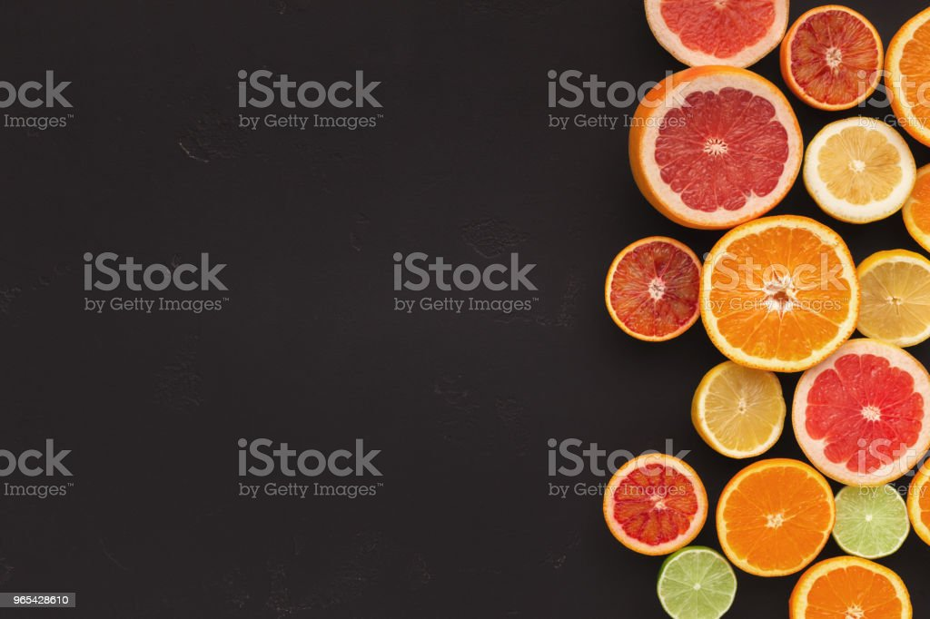 Variety of ripe citruses on black background royalty-free stock photo