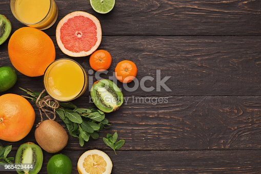 Variety Of Ripe Citruses On Wooden Background Stock Photo & More Pictures of Antioxidant