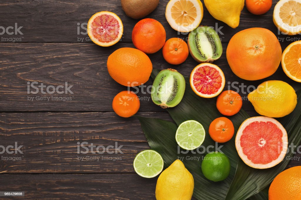 Variety of ripe citruses on wooden background royalty-free stock photo