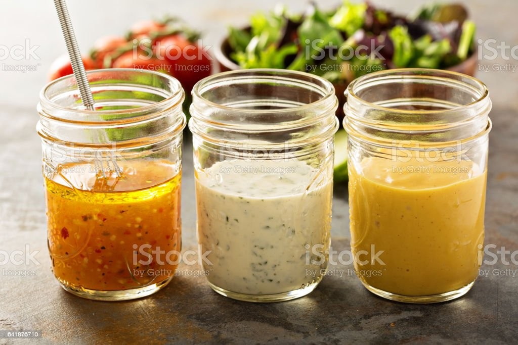 Variety of sauces and salad dressings stock photo