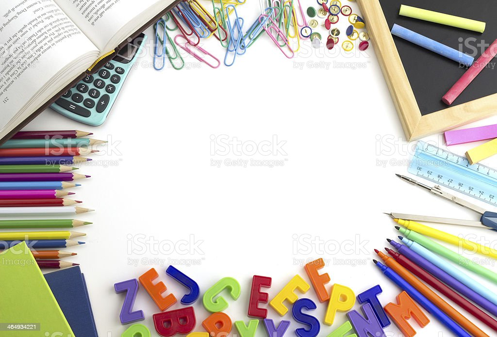 Variety of school supplies strewn across white table stock photo