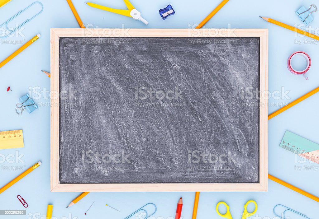 Variety of school supplies with blank blackboard. Back to school. ストックフォト