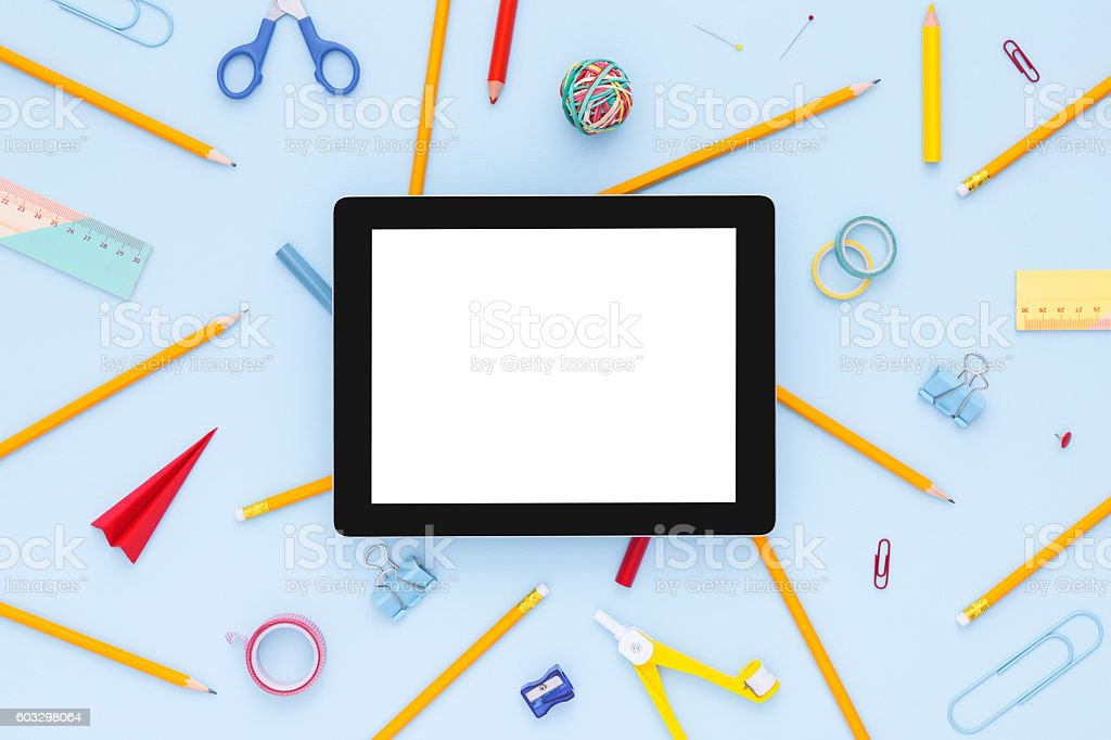 Variety of school supplies with blank tablet. Back to school. stock photo