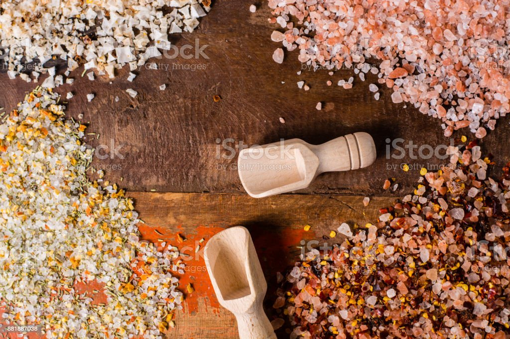 Variety of sea salt, pink Himalayan salt, colorful salt with dried chili pepper, herbs and spices stock photo