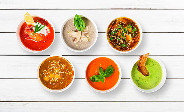 Variety of soups at white wood, top view stock photo
