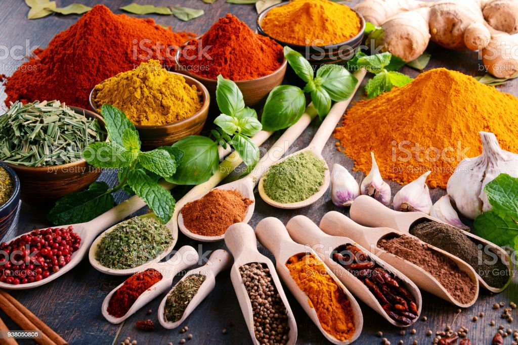 Variety of spices and herbs on kitchen table foto stock royalty-free
