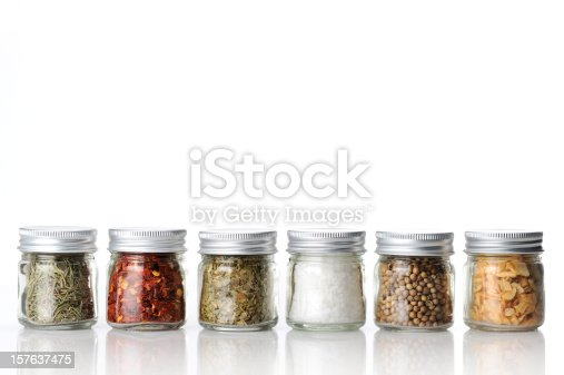 variety of spices, garlic flakes, rosemary flakes, bay leaves, coriander seeds, rosemary flakes, chili flakes and salt