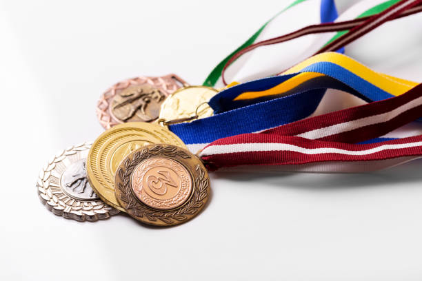 variety of sport medals on white stock photo