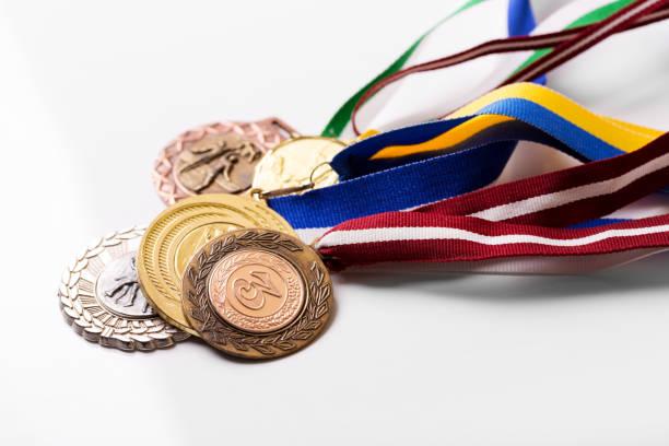 variety of sport medals on white - medal zdjęcia i obrazy z banku zdjęć