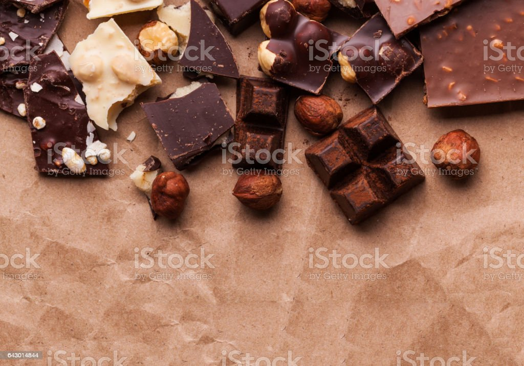 Variety of sweet homemade chocolate pralines on wooden background - foto de acervo