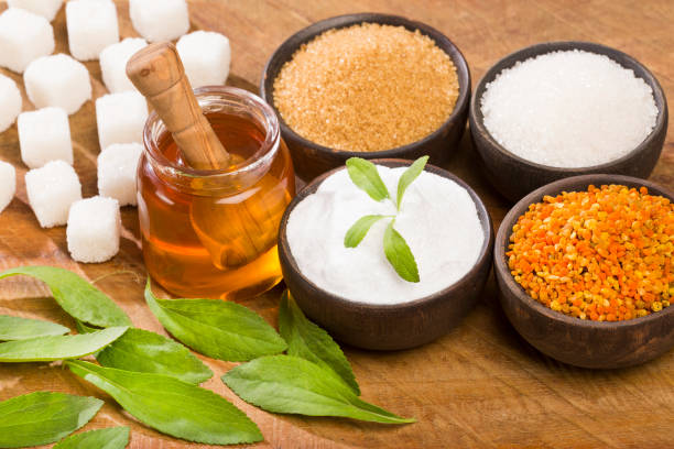 variety of sweeteners - stevia, sugar, pollen and honey - sweeteners stock photos and pictures