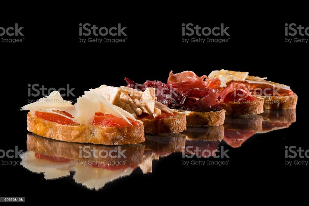 Variety of toasts. Spanish tapas stock photo