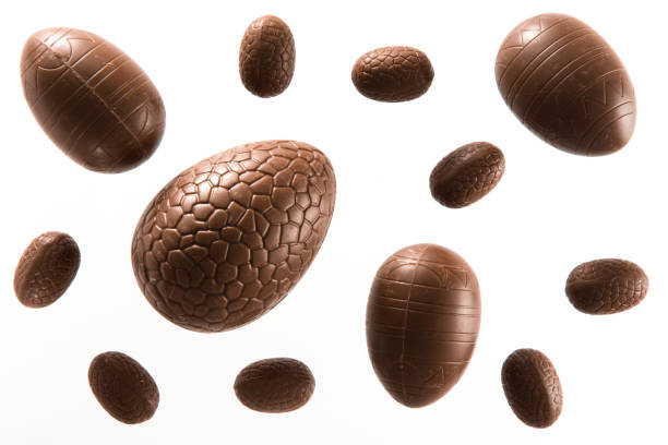 variety of unwrapped Easter chocolate eggs stock photo