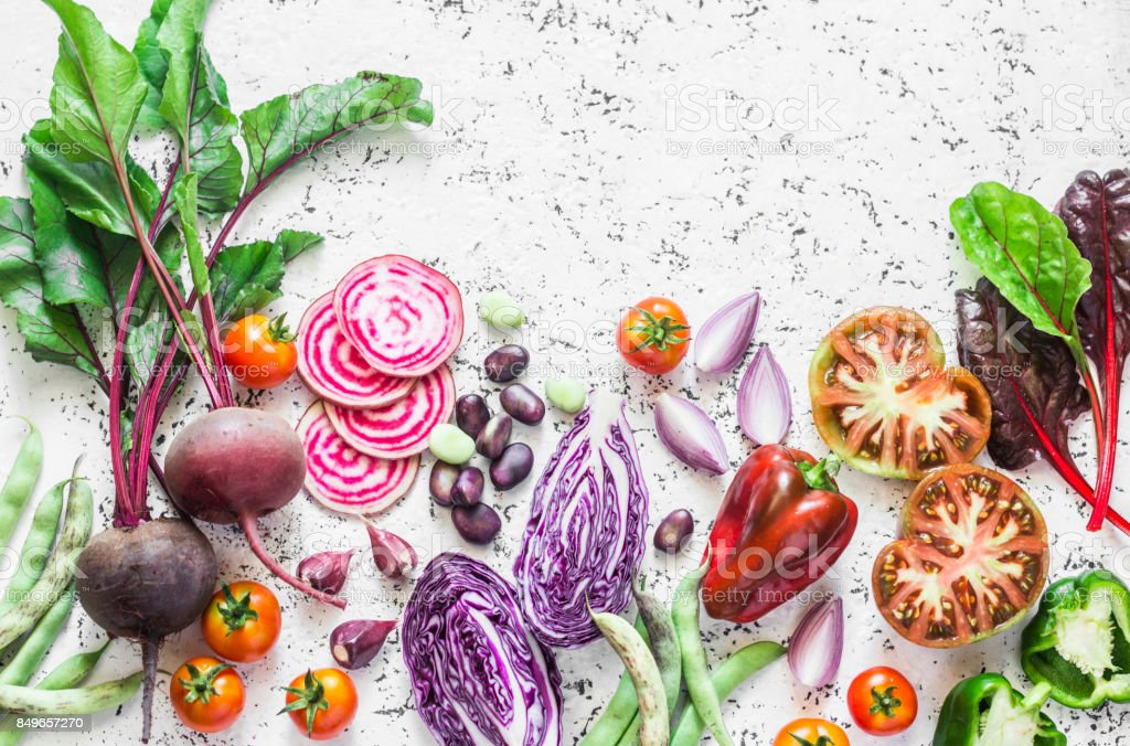 Variety of vegetables a light background. Beets, red cabbage, beans, tomatoes, red onions, peppers food background. Vegetarian food concept stock photo