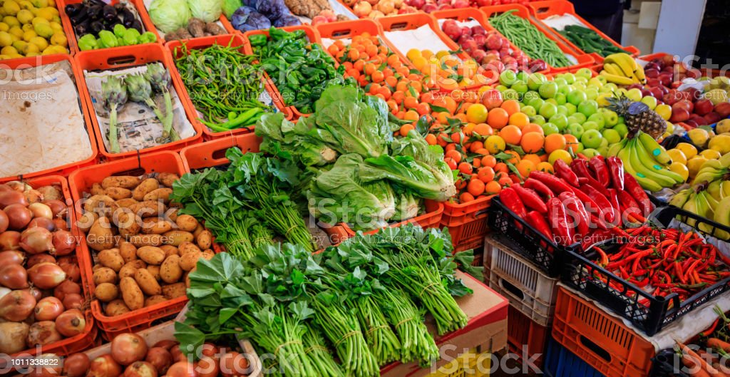 Variety Of Vegetables And Fruits For Sale In A Market In