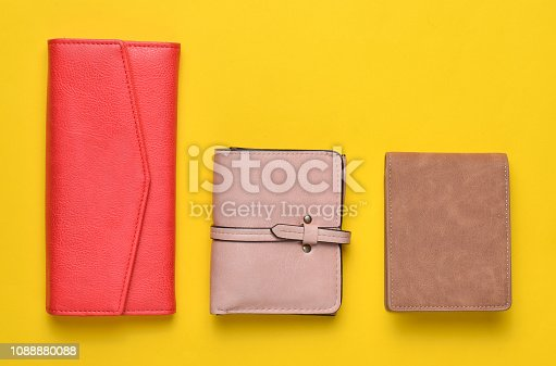 istock variety of women's leather wallets on a yellow pastel background, women's accessories, top view, minimalism 1088880088