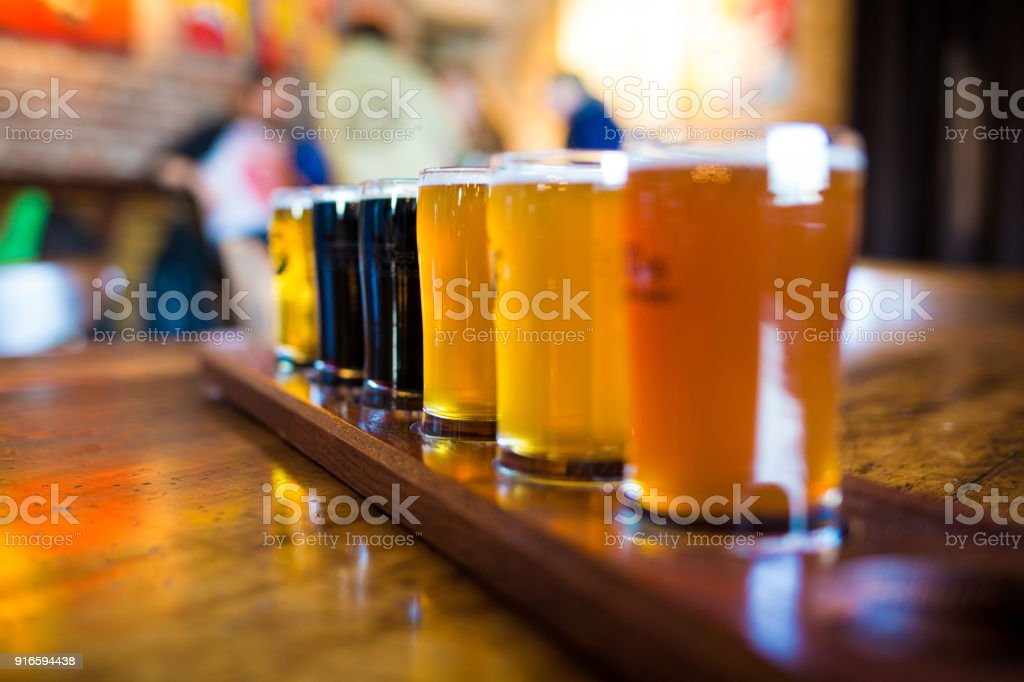 A variety set of craft beers light and dark stock photo