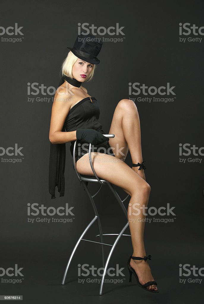 Variety show woman is sitting on bar chair. stock photo