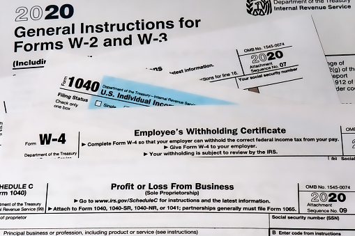 2020 US tax forms lay on a desktop in West Des Moines, Iowa.