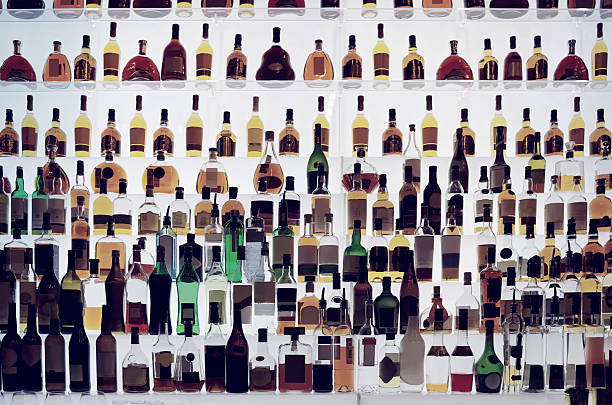Various alcohol bottles in a bar, toned stock photo