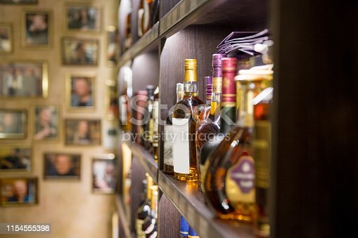 1013514594 istock photo Various alcohol bottles in the bar 1154555398