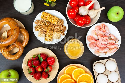various allergy food on wooden table background. Top view.