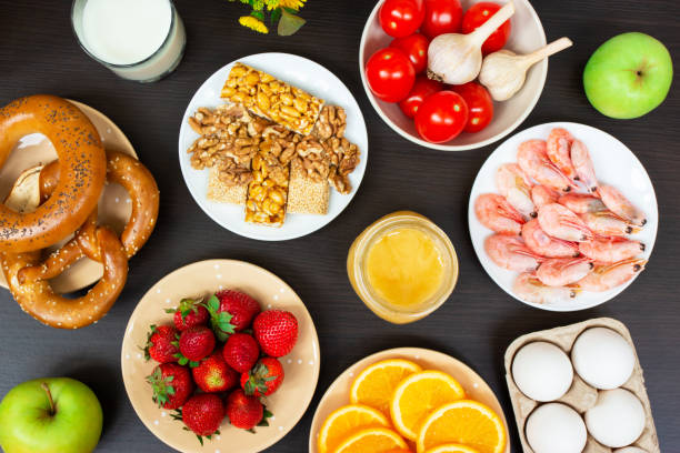 various allergy food on wooden table. Top view. various allergy food on wooden table background. Top view. flower part stock pictures, royalty-free photos & images