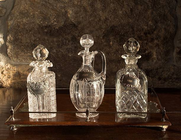 Various Antique Glass Decanters On Wooden Tray stock photo