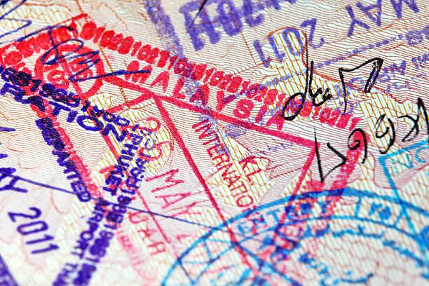 Various Asian stamps inside passport Close-up of passport with various Asian stamps (Thailand, Malaysia, Iran) pasport malaysia stock pictures, royalty-free photos & images