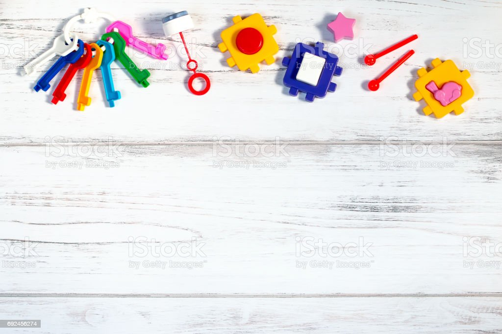 Various baby toys frame, copy space stock photo