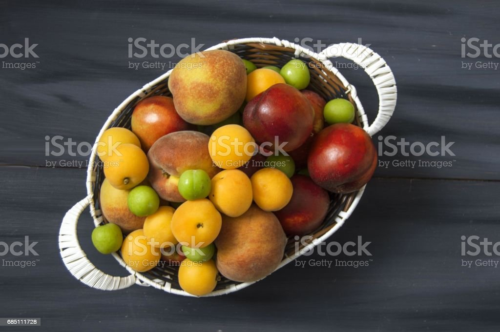 Various backgrounds and apricot, nectarine, peach plums royalty-free stock photo