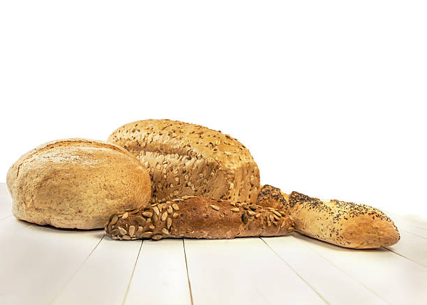 various baking bread isolated on white background - pone stock photos and pictures