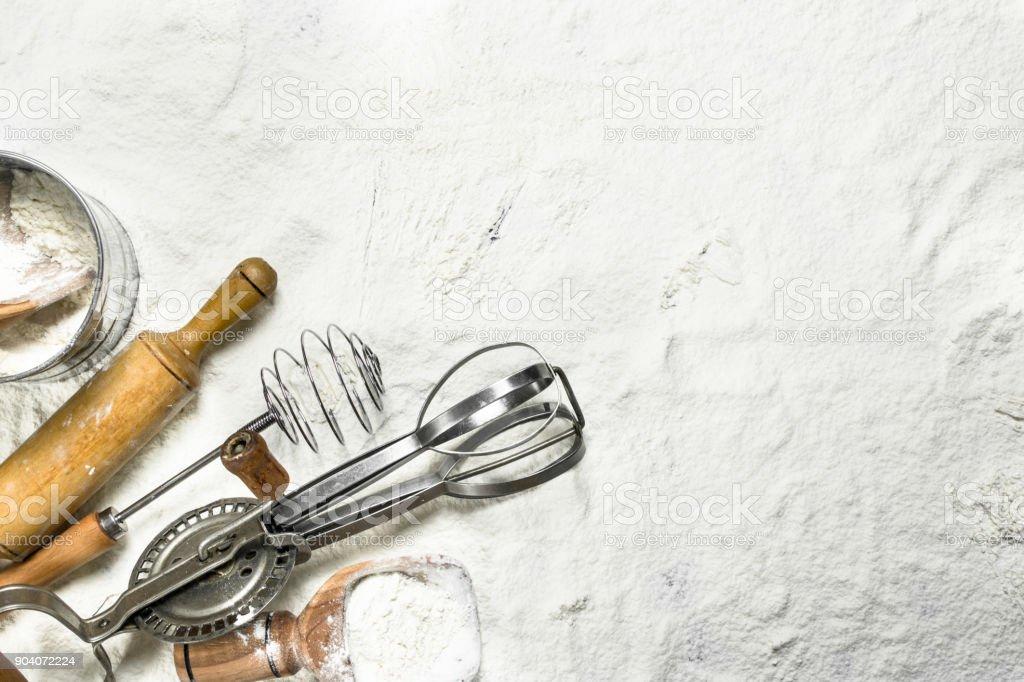 Various baking tools on flour. stock photo