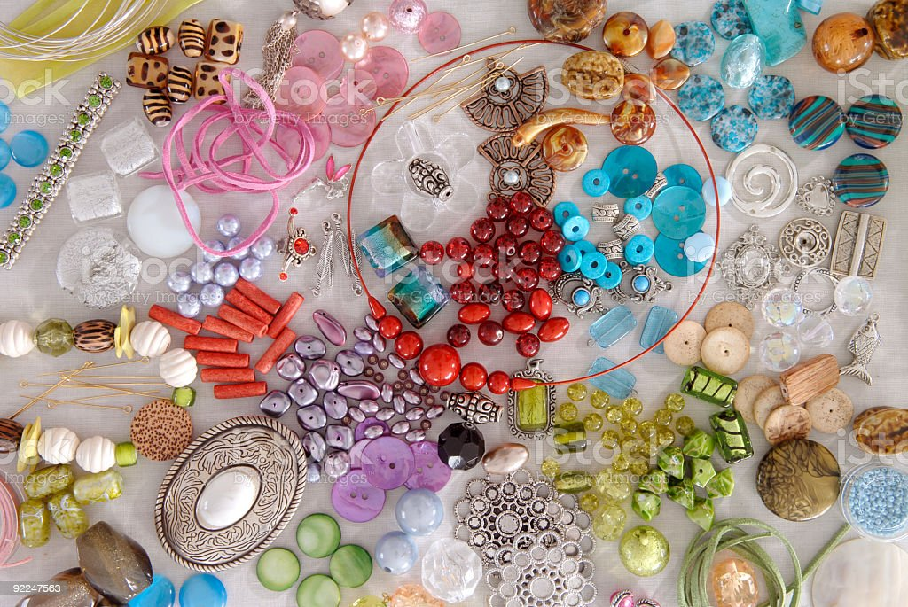 Various beads and other jeweler-making items stock photo