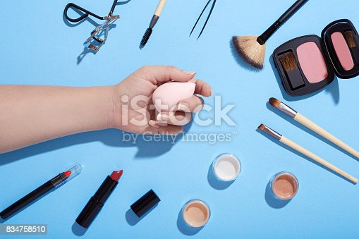 istock Various beauty products on blue background 834758510