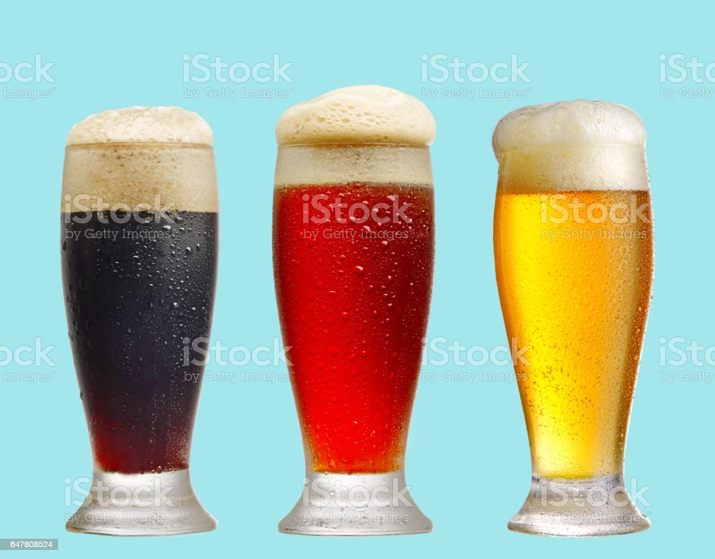 various beer glasses on blue background stock photo