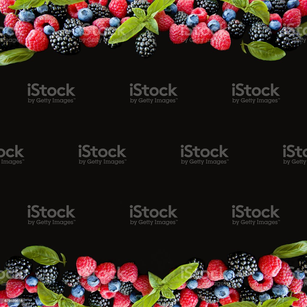 Various berries isolated on black background. Blueberry, raspberry and blackberry royalty-free stock photo