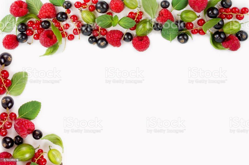 Various berries on white background. Ripe raspberries, currants, gooseberries royalty-free stock photo