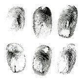 Macro shot of various black ink human fingerprints isolated on white background