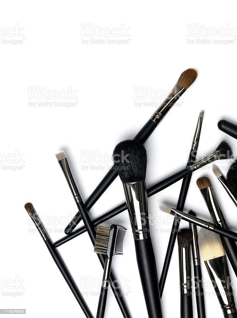 Various black make up brushes on a white background stock photo