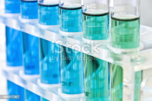 Test solution in the test tubes on shelf.