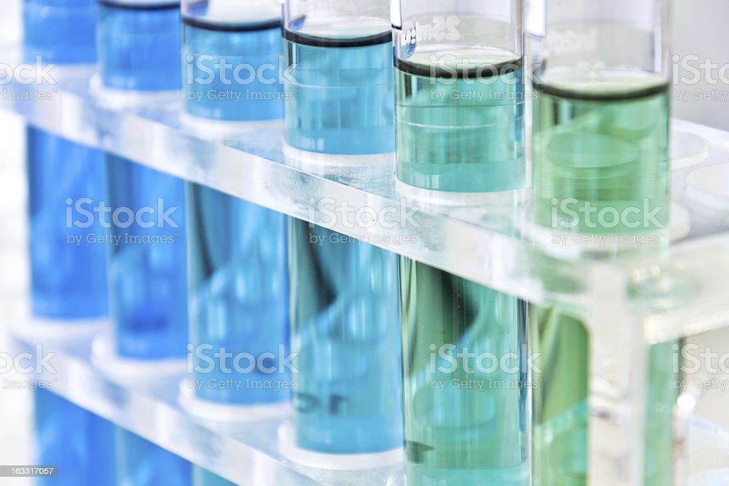 Various blue liquids in test tubes stock photo