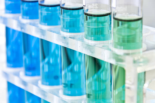 Various blue liquids in test tubes stock photo